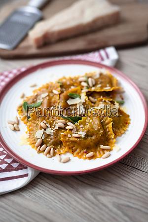 plate of pumpkin ravioli with sage