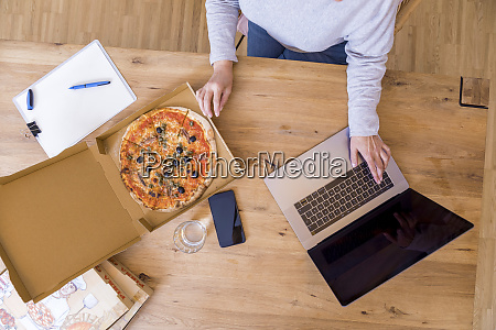 woman at home office using laptop