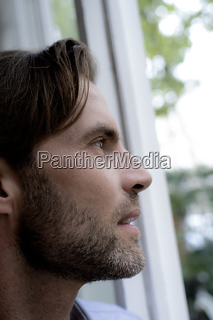 close up of man looking out
