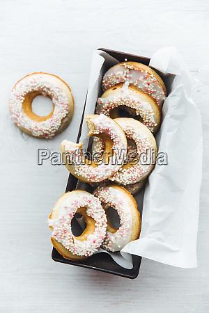 cake pan of homemade doughnuts with