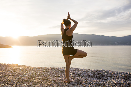 young woman doing yoga on a