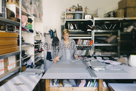 fashion designer working on template in