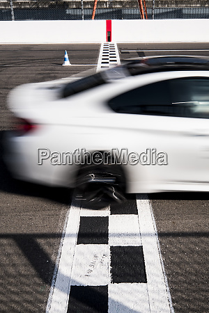 car crossing finishing line on racetrack