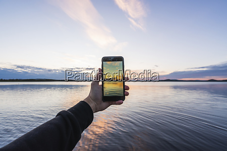 finland lapland man taking cell phone