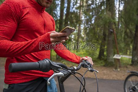 mountain biker using smartphone in a