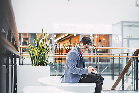 businessman in lobby of a modern