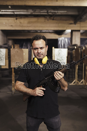 portrait of man holding a rifle
