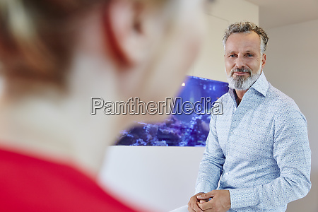 mature man looking at female colleague