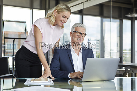 businessman and woman discussing project in