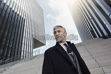 portrait of fashionable businessman in front