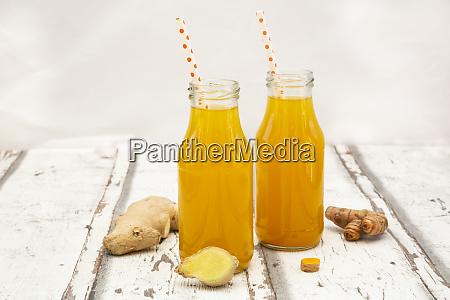 ginger shot with orange and curcuma