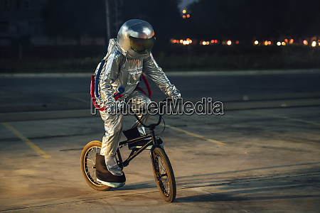 spaceman in the city at night