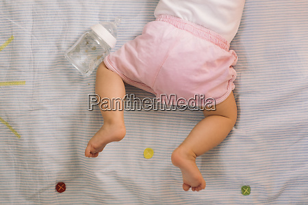 barefoot baby girl wearing pink knickers