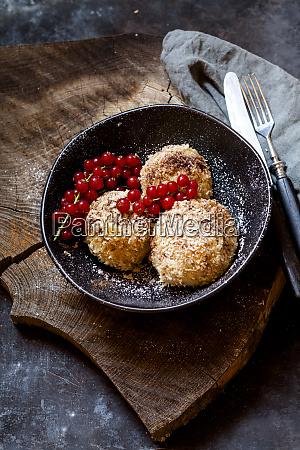 plum filled sweet dumplings with coconut