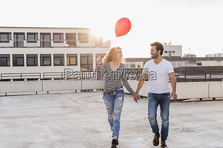 happy young couple on roof terrace