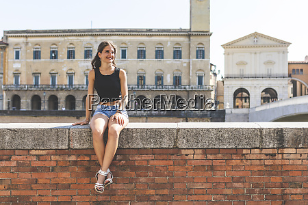 italy pisa young woman sitting on
