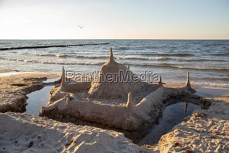 a sandcastle on the beach