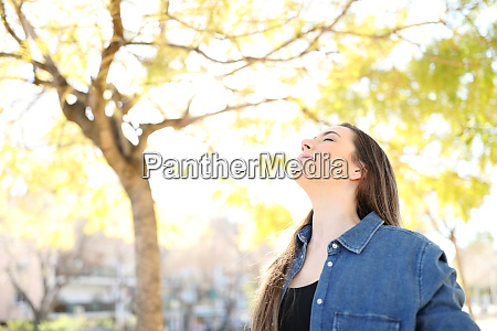 relaxed woman is breathing fresh air
