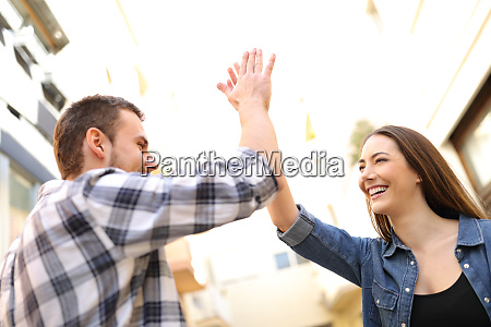 happy friends giving high five in