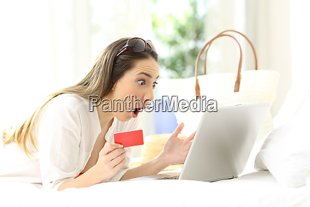 amazed woman buying on line in