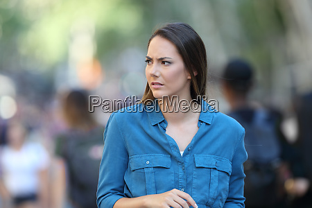 anxious woman walking on the street
