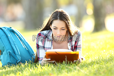 concentrated student learning memorizing notes