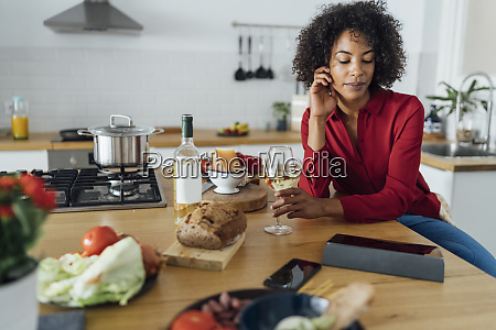 woman sitting in kitchen with a