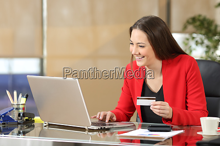 businesswoman buying on line with credit