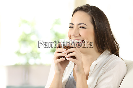 candid girl drinking cocoa shake at