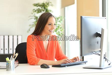 businesswoman working typing in a desktop