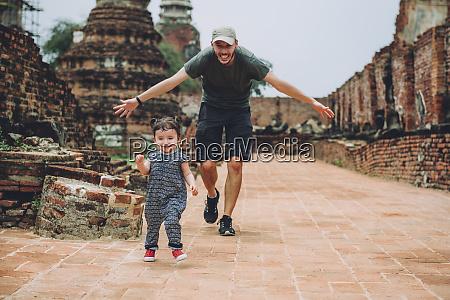 thailand ayutthaya father and daughter running