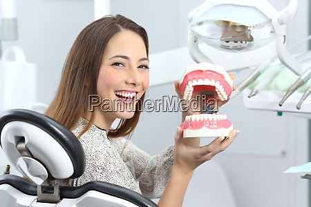 dentist patient smiling with a plastic