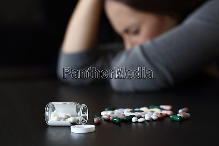 depressed woman beside a lot of