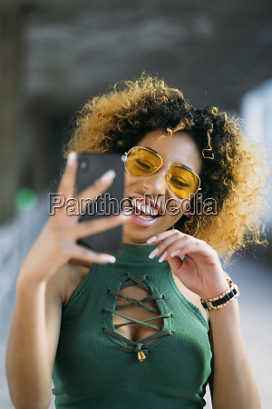 portrait of fashionable young woman using