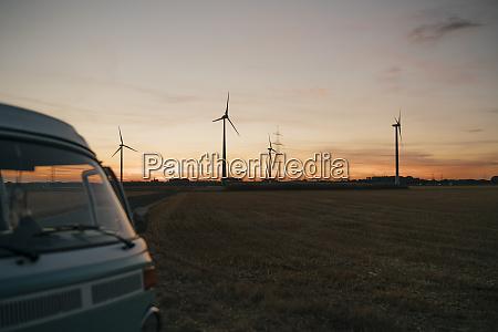 camper van in rural landscape with