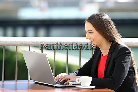 executive typing in a laptop in