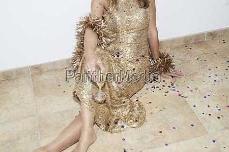 senior woman wearing golden dress celebtraing