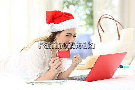 excited woman buying online on christmas