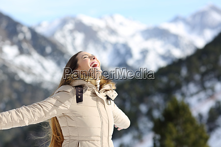 excited woman laughing in the mountain