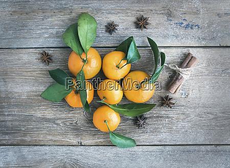 fresh mandarines with cinnamon sticks and
