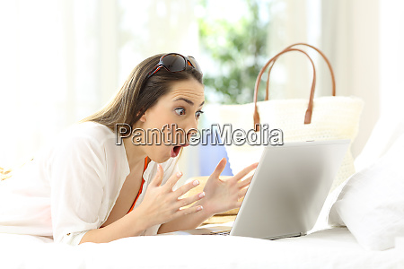 excited woman reading online content on