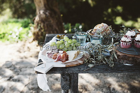 various delectable food standing on lumber