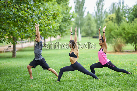 young people exercising yoga in a