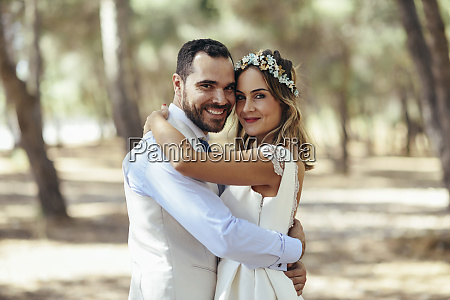 portrait of happy bridal couple standing