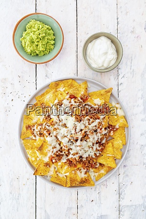 nachos with minced meat guacamole and