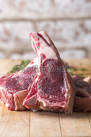 raw beef chops on a wooden
