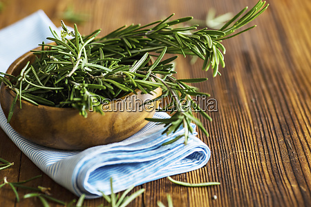 organic fresh rosemary herb on textile
