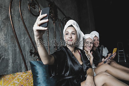 three women with towels around her