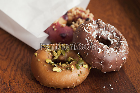 decorated doughnuts falling out of bag