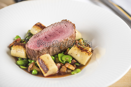 beef fillet with beans and chanterelle